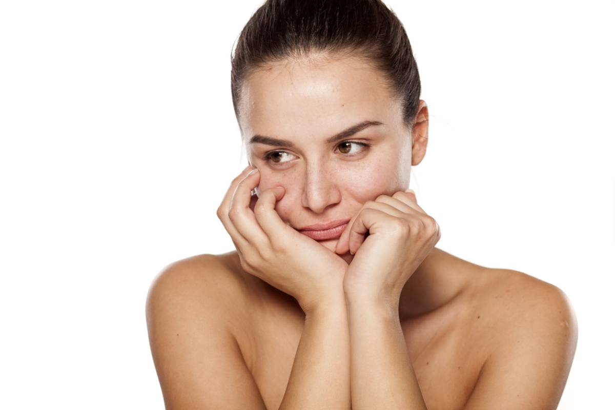 woman frowning with hands on her cheeks