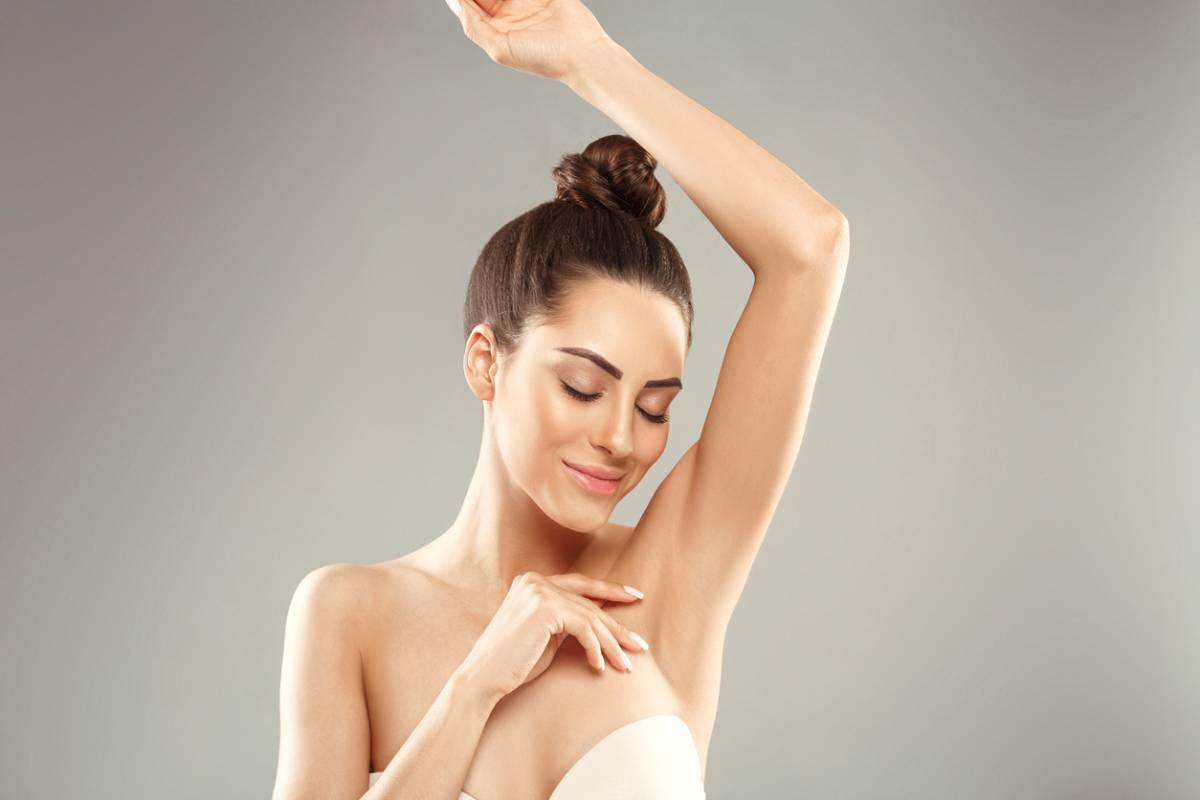 woman in white bra raising her left arm