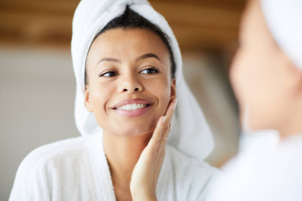 Woman at a Med Spa enjoying her recent results from a chemical peel.
