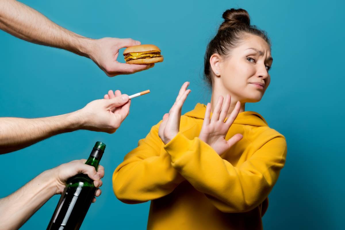 Woman refusing habits that would ruin her skin.