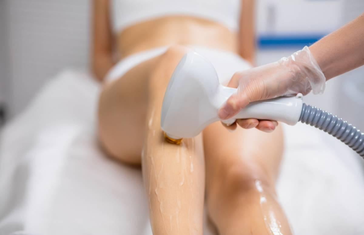 Woman having laser hair removal.